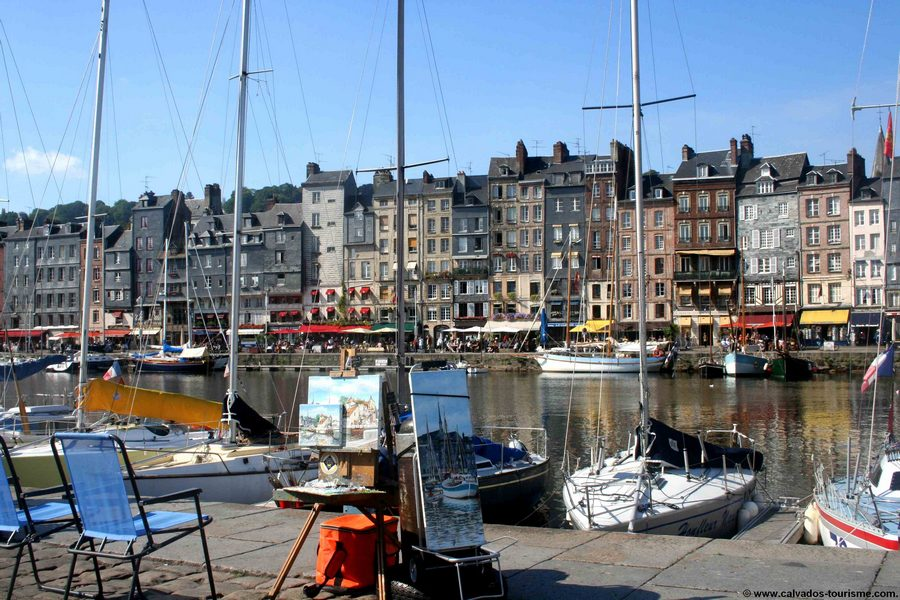 Beautiful light reflecting on the water of the old harbor of Honfleur
