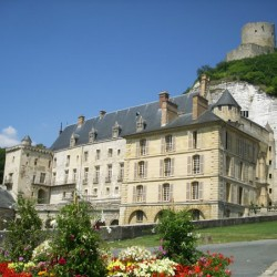 La Roche-Guyon chateau below the chalk cliff topped by a medieval defensive tower